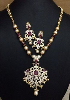 Peacock model AD and ruby stone pendant and screw earrings Code : 413 Price : 2195/- Length ; 22 inch long Whatsapp to 09581193795/- for order processing...