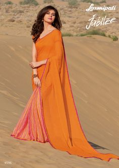 Browse this Stunning Orange #Chiffon Half & Half Stone Work #Saree and Orange Pashmina Blouse along with Fancy Lace Border from #Laxmipatisarees. Catalogue- Jubilee, Design Number: 4596, Price: ₹ 2492.00  #Jubilee0417