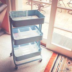 Use Ikea's Raskog rolling cart & Antonius plastic storage to organize your scrapbooking supplies.