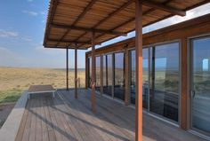 A Petite Prefab With Stunning Views of the Texas Landscape - Photo 5 of 8 - Large canopies shade the retreat's southern elevations, rendering the interior and ipe wood patio comfortable in the Texas heat.