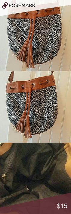 Bucket style Crossbody bag Cognac trim with a black and white tribal print. Bucket style with a crossbody strap. Originally purchased from pacsun. Bags Crossbody Bags