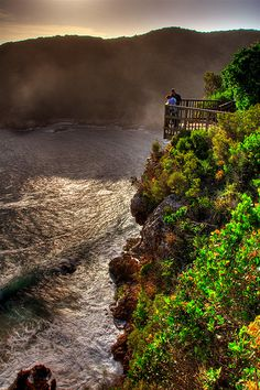 Mist rolls through the Knysna Heads, South Africa. BelAfrique - your personal travel planner