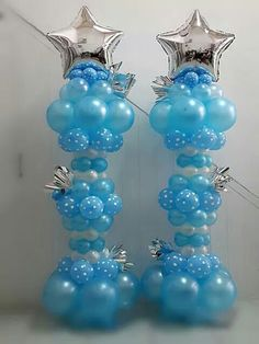 "Fun balloon columns for a boy's birthday party, ""Frozen"" theme, or other ""wintry"" occasion."