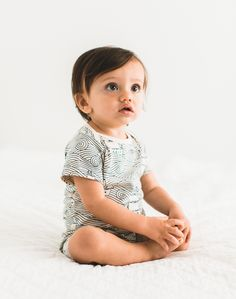 So cute baby boy in his simple white romper with blue high seas illustration detail. Short sleeves make this outfit perfect for spring and summer playtime and easily transitions into jammies. Made from organic cotton so it's eco friendly for stylish hipster babes, from Noble Carriage's Winter Water Factory collection. PHOTOGRAPHY BY: http://studiocastillero.com/