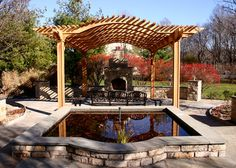 Patio Pergola with Arched Top - Located over a large patio area to provide shade, this magnificent pergola also establishes a strong focal point and gathering area between a fountain on one end and a fireplace on the other. The overhead curve of the pergola reflects the large curved wall of the patio and accents the fireplace. Double rafters sandwich simple support brackets.  http://www.trellisstructures.com/pergolas/ctp08-contemporary-pergola.html