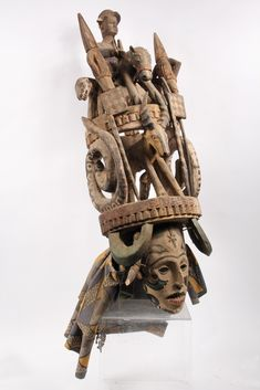 AFRICAN MASK - Igbo Peoples, Southeast Nigeria, Agbogho Mmuo or Maiden Spirit Mask surmounted by elaborate arrangement of oxen, snakes, leop...