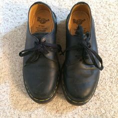 Black Doc Martens These black Doc Martens have hardly been worn. There are a few small scuffs around the toe, otherwise perfect condition. UK size 5, US size 7. Dr. Martens Shoes