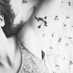 simple-bow-and-arrow-tattoo-on-sleeve