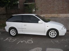 Suzuki Swift GTI.  Only year of GTI name.  Mine was same color.  Fun quick little car
