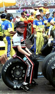 Dale Earnhardt Jr. yawns while sitting on a tire in pit row during the Pontiac Excitement 400 race on February 25, 1990 at the Richmond Fairgrounds Raceway in Richmond, Virginia.