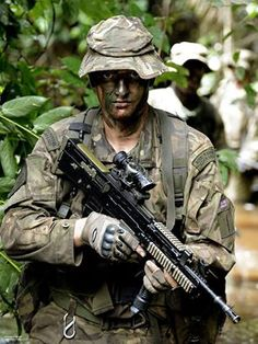 A Royal Marine with 45 Commando pictured during jungle training on Exercise African Winds at the Jungle Warfare School, Ghana.  Exercise African Winds 2013 was a Dutch-led multi- national operation including the Dutch Marines, the US Marine Corps and the Royal Marines and currently taking place in Ghana. The Royal Marine element was made up from Whisky Company 45 Commando Unit.    Picture: PO Paul A'barrow