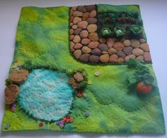 Vegetable Garden playmat, a place to grow stories and language skills as well as to play.