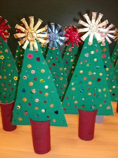 My group made Christmas trees using cardboard (painted), recycled beads (undid old necklaces), tp roll covered with fabric scraps and a ...
