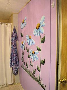 Painted flowers on bathroom wall by Milda.