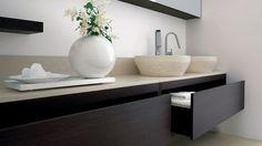 Dogi bathroom by GD Cucine -Dark brown ash-wood vanities- Honed Biancone stone countertop and washbasins
