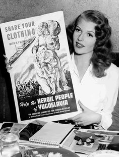 Rita Hayworth holding a poster of the American Committee for Yougoslav Relief, 1945