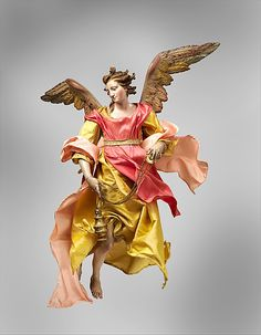 Angel  Giuseppe Sanmartino (Italian, 1720–1793)   second half 18th century Culture: Italian (Naples) Medium: Polychromed terracotta head; wooden limbs and wings; body of wire wrapped in tow; various fabrics. Dimensions: H. 17 1/4 in. (43.8 cm.)