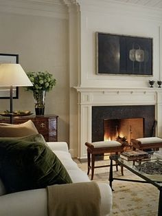 :: Havens South Designs :: loves this formal living room by Victoria Hagan and thinks the art may hide a TV