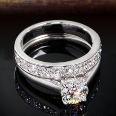 Кольцо с бриллиантами двойное  Двойное кольцо с бриллиантами. Белое золото 750 пробы. Центральный бриллиант круглой огранки 0.83 карта. Двойное кольцо для предложения руки, помолвки и свадьбы.      Кольцо с бриллиантами двойное  Характеристики вставок: 36 бриллиантов, круглой огранки, 57 граней, 2/3, 0.36 карат Центральный бриллиант: Форма: Круглая    Вес: 0.83 карата Цвет: I    Чистота: SI1    Огранка: Good Белое золото: 750 проба Вес изделия: 4.07 грамм Изготовитель: Италия