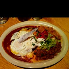 Red chile blue corn enchiladas with egg on top at Doc Martin's in Taos!  Yummmmm!