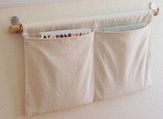 SIMPLY HUNG POCKETS. Tute for simple construction.Use for any number of things: sewing things next to your machine, craft stuff, reading nook for kids, incoming and outgoing mail. Repurpose kitchen towels or table linens.