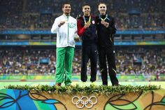 Silver medalist Taoufik Makhloufi of Algeria, gold medalist Matthew Centrowitz of the United States and bronze medalist Nicholas Willis of New Zealand stand on the podium during the medal ceremony for the Men's 1500 meter on Day 15 of the Rio 2016 Olympic Games at the Olympic Stadium on August 20, 2016 in Rio de Janeiro, Brazil.