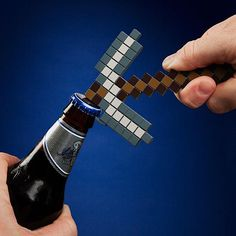 Minecraft Pickaxe Shaped Bottle Opener... Evan would love opening my craft beers with this.