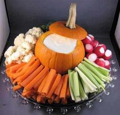 Put your dip for a veggie tray in a small pumpkin.  This could be done where your dip is still in the bowl inside the pumpkin