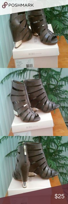 BCBG WEDGE SANDELS Pretty leather strappy  wedge Sandle. Cute gold tone wrap around lower heel. Small scuff on this area from driving. Otherwise these sandals  are absolutely  gorgeous. BCBG Shoes Sandals