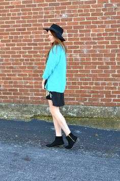 Affordable Spring outfit ideas - sweater overtop of floral dress and boots