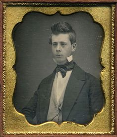 Daguerreotype portrait of handsome young gentleman with swept hair. 1850/1855
