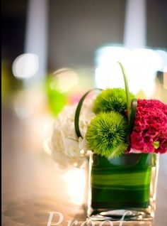 cute cube arrangement made of white hydrangeas, pink celosia and green dianthus