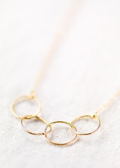 Kalei necklace - delicate gold necklace with infinity circle links, 14kt gold filled layering necklace, handmade by kealoha, maui, hawaii by kealohajewelry on Etsy https://www.etsy.com/listing/117298014/kalei-necklace-delicate-gold-necklace