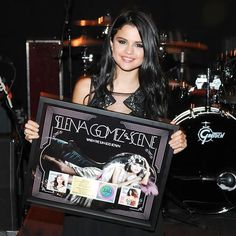 Selena with an award for her album when the sun goes down back in 2011.