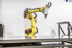 The popular FANUC robot is a long reach robot with incredible application versatility. New and reconditioned robots are available at RobotWorx. Industrial Robotic Arm, Industrial Robots, Robot Arm, Robot Design, Futuristic Technology, 3d Projects, Weapons, 3d Printing, Arms