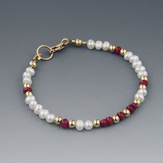 White Seed Pearl and Genuine Ruby Bracelet with 14K gold. By Transfigurations Jewelry.