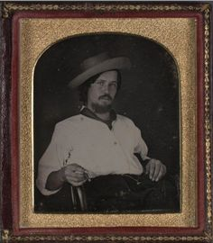Fulton, an early San Francisco actor. Half length portrait, seated, wearing a hat and holding a cigar. Daguerreotype. 1847.