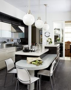 Round lamps over kitchen island
