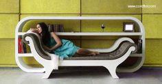 """Sofa recamier """"calado"""" en una bibioteca moderna de lineas suaves pero mueble de grosor balanceado en color blanco. En su sala este sofa biblioteca puede causar tanta atracción como una escultura moderna."""