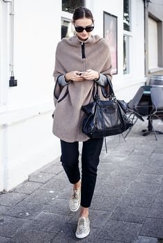 fall / winter - street style - street chic style - fall outfits - casual outfits - comfy outfits - camel knit cape + black ankle pants + grey sweater + gold glitter sneakers + black sunglasses + black handbag - athleisure
