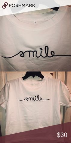 "a2bd67fd White T-shirt With Cursive Lettering White t-shirt with the word ""smile"