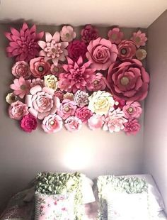 Our larger paper flowers make a beautiful backdrop to any room, party, or event. Each flower is hand cut, sculpted, and assembled. The color combinations are endless. Flowers will have a variety of different flowers ranging in size from 6inches to 20 inches. Every flower will be slightly different since they are each handmade. Each flower has a metal loop on the back to give options for hanging. Can easily be hung with flat thumb tacks, 3m double stick adhesive, or Velcro. They also lo...