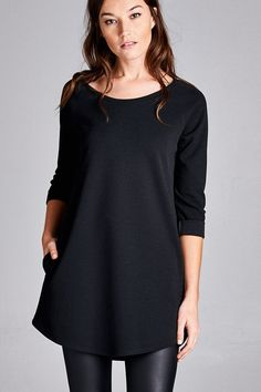 Lindsey Black Tunic with PocketsLindsey black tunic with pockets is loose fit with three-quarter sleeves and round neck. It features rolled sleeves that are tacked, rounded hem and pockets at the side seam. This tunic is made with a heavy weight crepe-like textured knit fabric that is soft and drapes well.