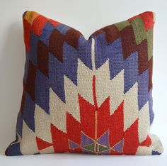 Sukan / Organic Shine Society Modern Bohemian Throw Pillow. Handwoven Wool Vintage Tribal Turkish Kilim Pillow Cover 16x16. $179.95, via Etsy.