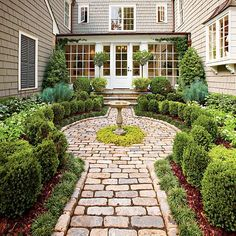 Cobblestone path leads in to an all-green cottage garden!