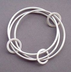 Eternity Bangle by Kim Channon. Hand forged from solid sterling silver