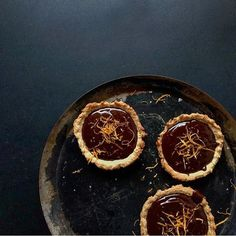 I want to go to @charlottehuco for afternoon tea to eat these amazing looking orange chocolate tarts (c/o @lindoruk) that she made - what a dreamy picture too.
