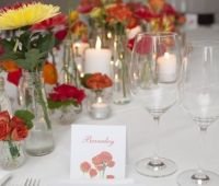Designed by Event Scene Adelaide.   A burst of colour with a hand painted design on the place cards to match. #happy #tablescape #eventstyling