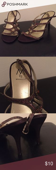 *M by Marinelli* woman's heels 8.5/10 condition.  Great conditon. Glittery material on the laces. Satin material all around shoes. Size 7.5. Heel is 3 inches long. Minimal wear/ tear all around both shoes ( see pictures).I am a businessman, make me an offer I cant refuse! Please do not hesitate to ask any questions or for more pictures. Thank you for your time and have a wonderful day! M by Marinelli Shoes Heels