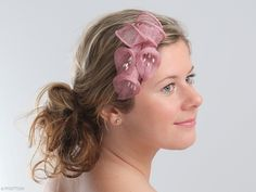 Eve is a charming fascinator formed into a subtle Calla Lilies arrangement with shiny beads. The fascinator attaches with a comb and can be worn at right or left side of your head. This headwear is hand formed and sewed, making it an exclusive design. This artisan cocktail fascinator would beautifully underpin a romantic look; ideal for maid of honour or bridesmaids. It would also look fantastic in white or ivory.